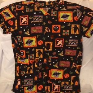 Halloween scrub top. Washed and worn.